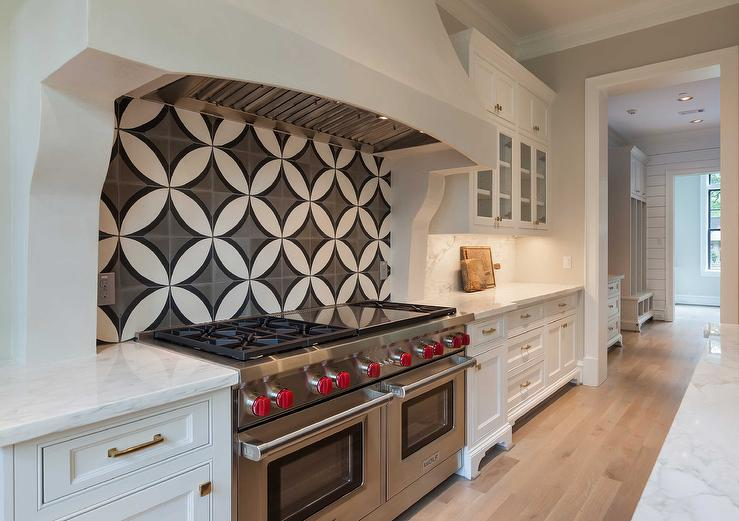Kitchen cooktop with black and white cement circle backsplash tiles transitional kitchen - Black and white tile kitchen backsplash ...