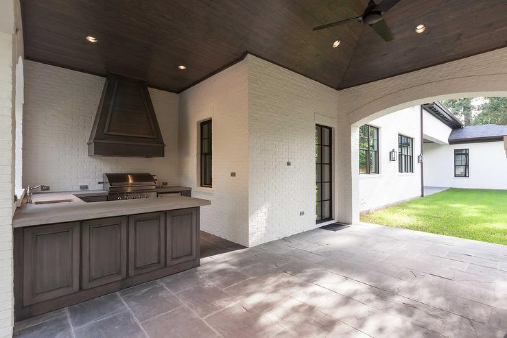 covered patio with walnut stained outdoor kitchen cabinets With what kind of paint to use on kitchen cabinets for outdoor patio wall art