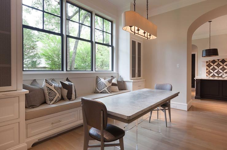 view full size. Chic dining room boasts a long built in window seat ...