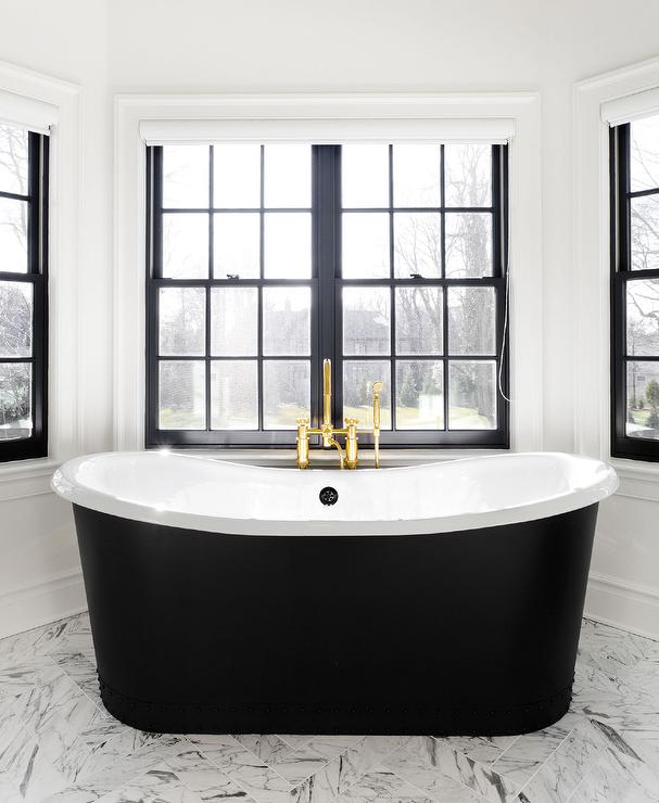 Black Bathtub Under Window Dressed In Schumacher