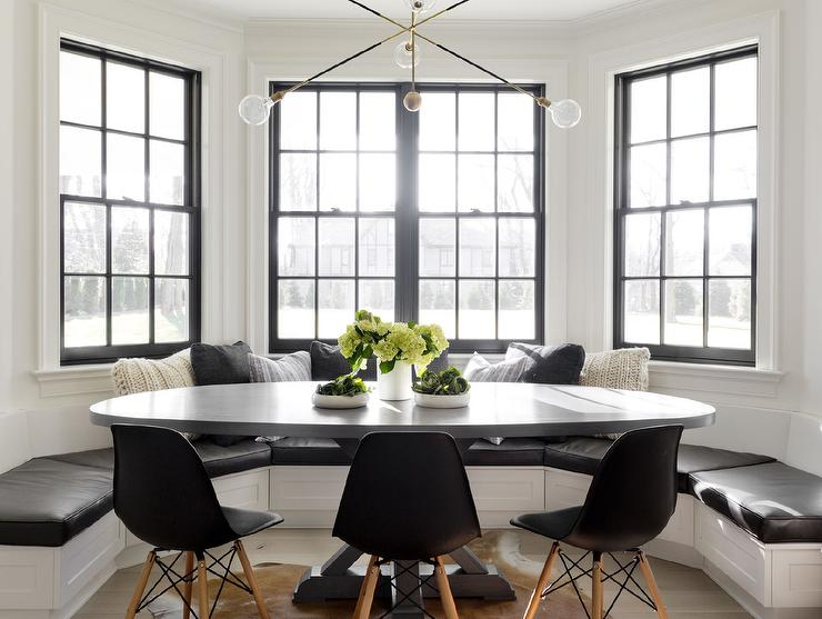 Black And White Bay Window With Built In Banquette Oval Dining Table