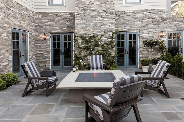 Patio Square Concrete Fire Pit With Dark Gray Adirondack Chairs