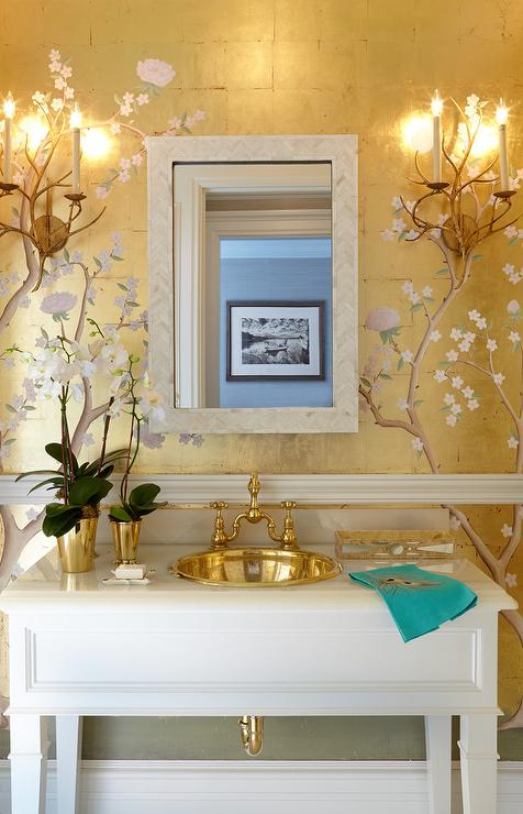 chinoiserie powder room with gold metallic wallpaper and chair rail