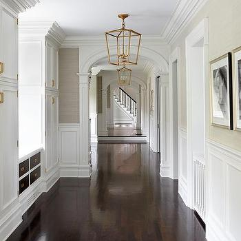 Long Hallway With Built In Cabinets Adorned With Brass Hardware