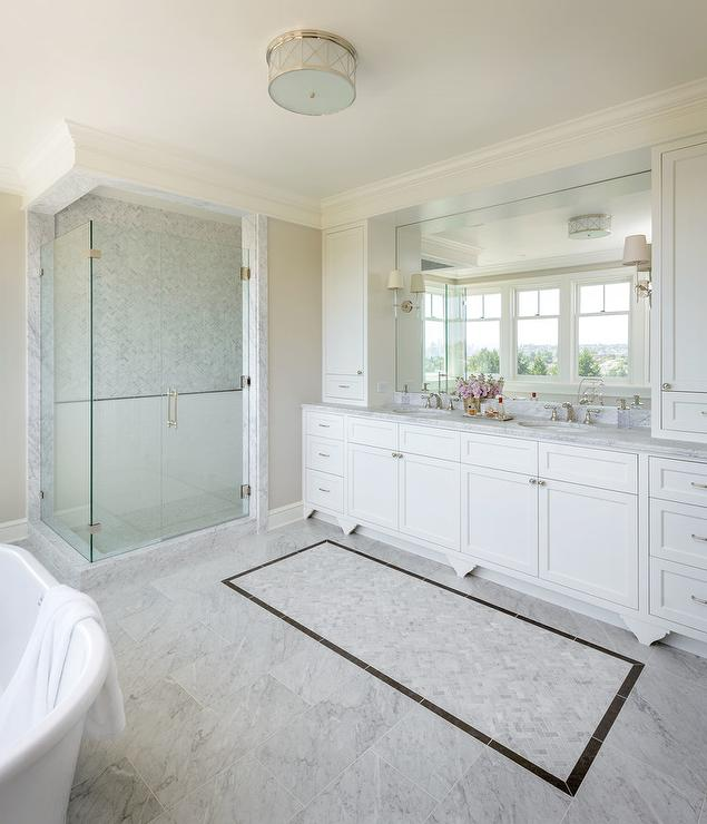 Master bath with white subway tiles with marble pencil Master bathroom tile floor