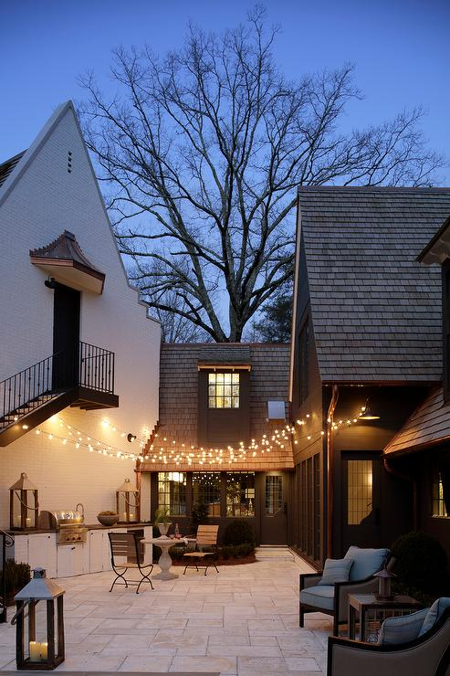 Patio With Fairy Lights And Outdoor Kitchen