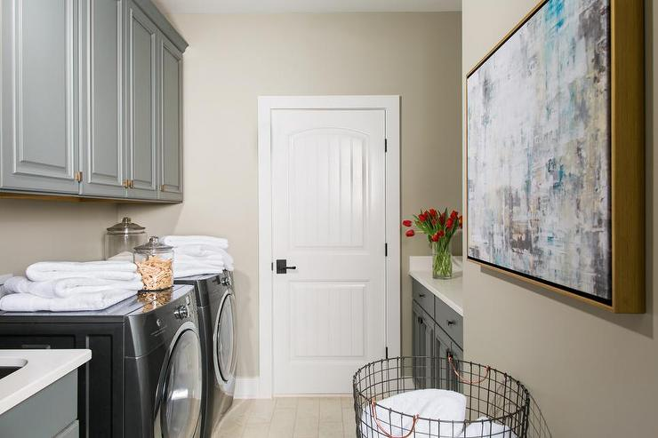gray raised panel laundry room cabinets with aged brass hardware - Raised Panel Home 2015