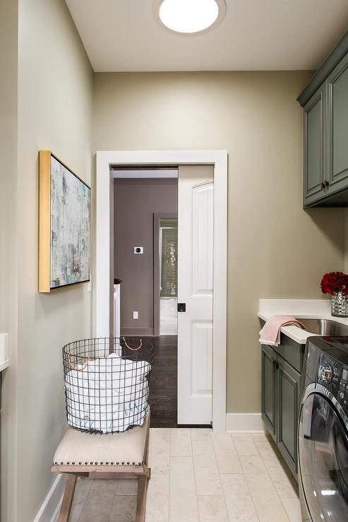 Laundry Room With White Beadboard Panel Pocket Door