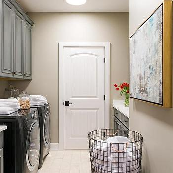 Gray Raised Panel Laundry Room Cabinets With Aged Brass