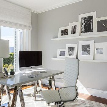 Chrome Sawhorse Desk Next To Stacked Floating Picture Ledges