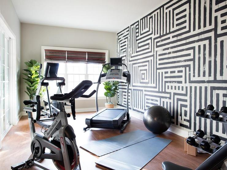 Black and white home gym with graphic hand painted wall