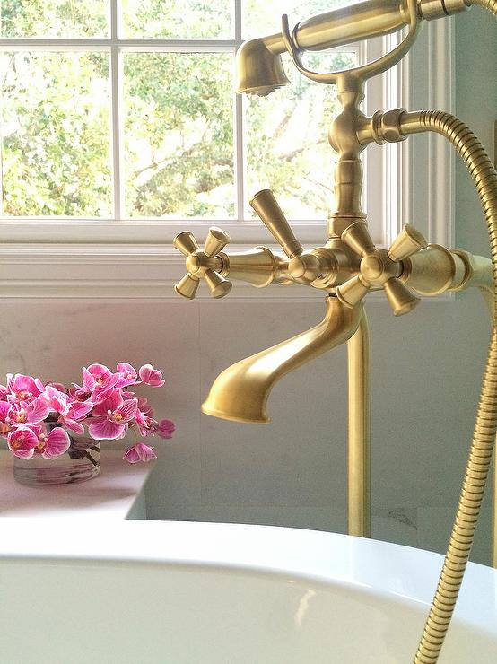 Oval Bathtub With Aged Brass Vintage Hand Held Tub Filler