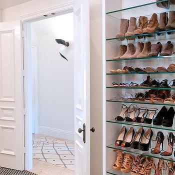 Walk In Closet With Bi Fold Doors With Glass Shoe Shelves
