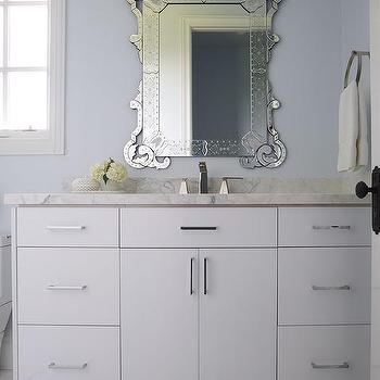 White And Blue Bathroom With Venetian Mirror
