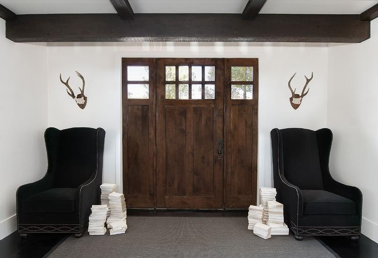 Modern Cabin Foyer With Black Velvet Wingback Chairs