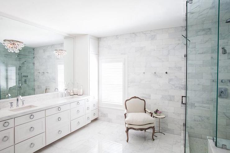 Bathroom Sconces In Mirror sophisticated master bathroom with robert abbey bling sconces on