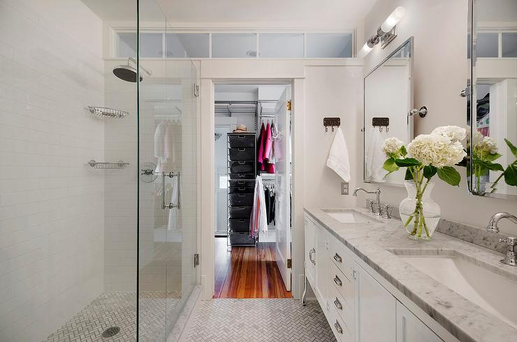 Chic Walk Through Master Bathroom Boasts A Restoration Hardware Pharmacy  Double Vanity Topped With Carrara Marble Fitted With White Porcelain Sinks  And ...