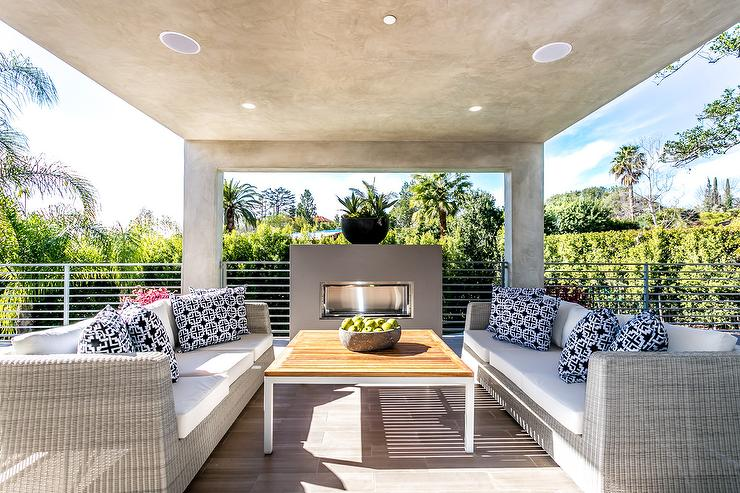 Gray Wicker Outdoor Sofas Facing Each Other With Modern Fireplace