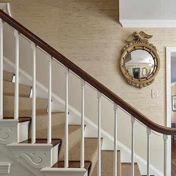 Superbe Gold Eagle Convex Mirror On Tan Textured Staircase Wall