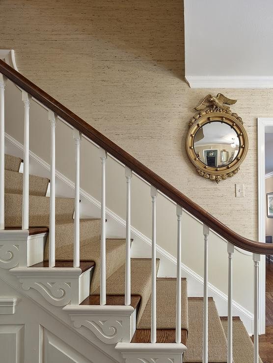 Wonderful Gold Eagle Convex Mirror On Tan Textured Staircase Wall