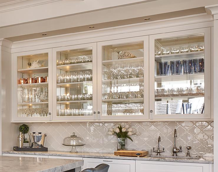 Superbe Wet Bar With Glass Front Cabinets And White Glass Arabesque Tile Backsplash
