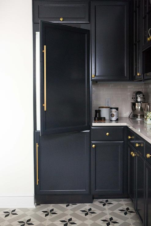 Black Paneled Refrigerator And Freezer With Brass Door