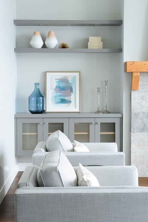 Gray living room alcove boasts gray built in frosted glass cabinets