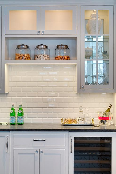 Kitchen Bar With White Beveled Subway Tiles And Overhead Shelf