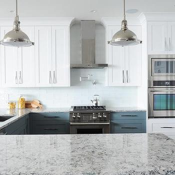 White and navy kitchen design with gold pendants for Navy blue granite countertops