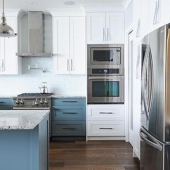 White Beach House Kitchen With Linear Glass Backsplash