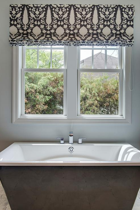 Black bathtub under window dressed in schumacher for Schumacher chenonceau charcoal wallpaper