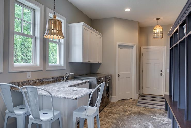 laundry room and mudroom combo with white and black granite