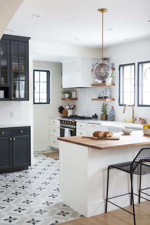 Black And White Themed Kitchen Boasts Stunning Star Tiles From The Cement Tile Accented By Side Board Cabinets With China On Top