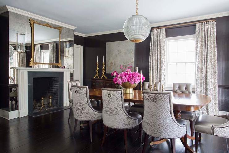 dining room with antiqued mirrored fireplace wall - transitional