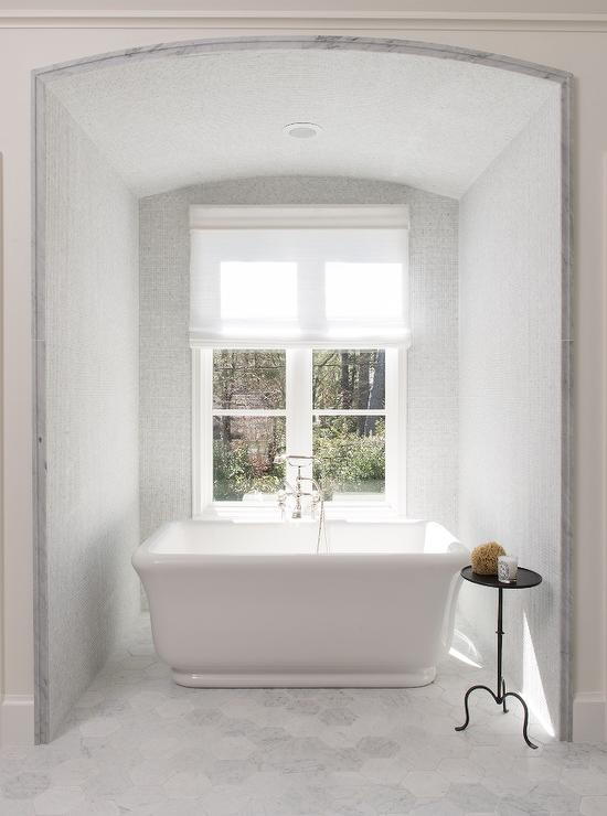 Gray Tub Nook With Large Hex Marble Tiles