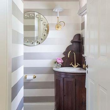 Powder Room With Gray Striped Walls And Corner Vanity