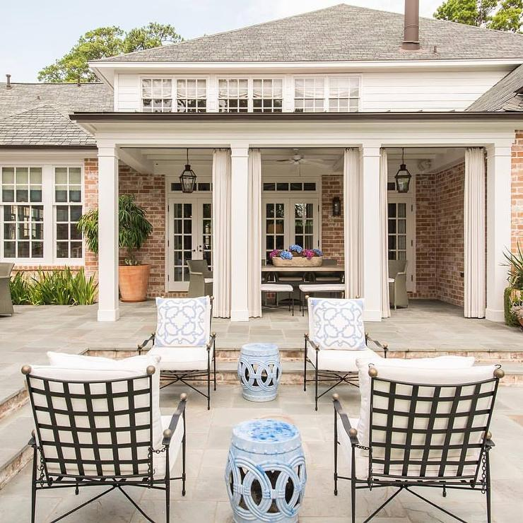 wrought iron patio chairs with brass trim and blue rope stools