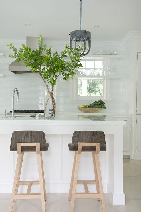 White Kitchen With Floating Shelves In Front Of Window