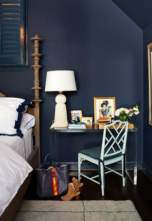 Blue Bedroom With Clear Acrylic Desk As Nightstand
