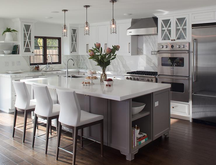 Gray Footed Center Island With White Leather Counter Stools