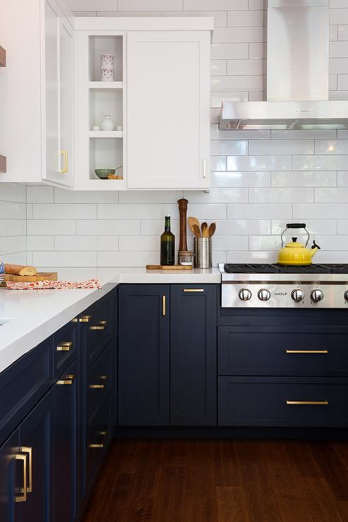 White Upper Cabinets And Navy Lower With Long Brushed Brass Pulls