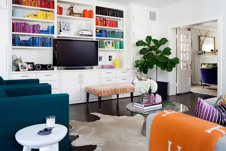 White Living Room Bookcase With Books Arranged By Color