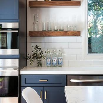 navy blue kitchen cabinets with brushed brass pulls and. Black Bedroom Furniture Sets. Home Design Ideas