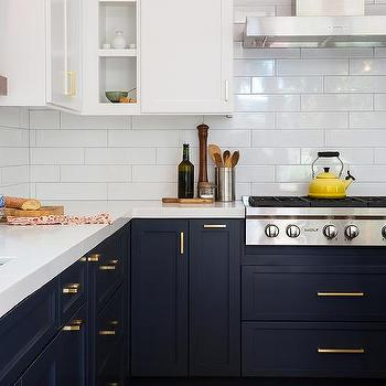 Navy Blue Kitchen Cabinets With Brushed BRass Pulls And White Marble