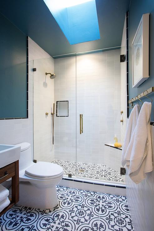 Walk in shower with black and white quatrefoil cement tile for Blue and black bathroom ideas