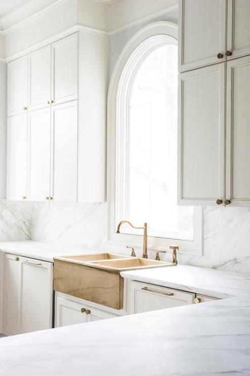 Stacked Kitchen Cabinets With Brass Dual Apron Sink