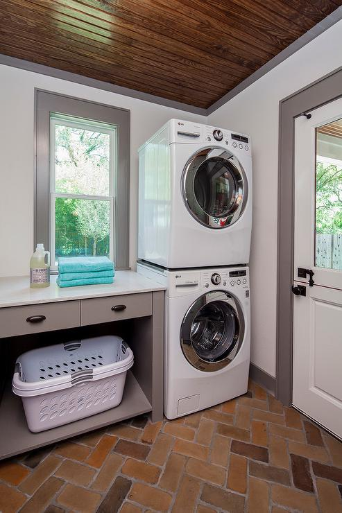Gray Laundry Room With Brick Herringbone Paver Floor