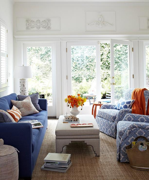 Stunning Blue, Gray, And Orange Living Room Boasts A Gorgeous Blue Tufted  Sofa Decorated With Assorted Blue And Orange Accent Pillows Positioned  Facing A ...
