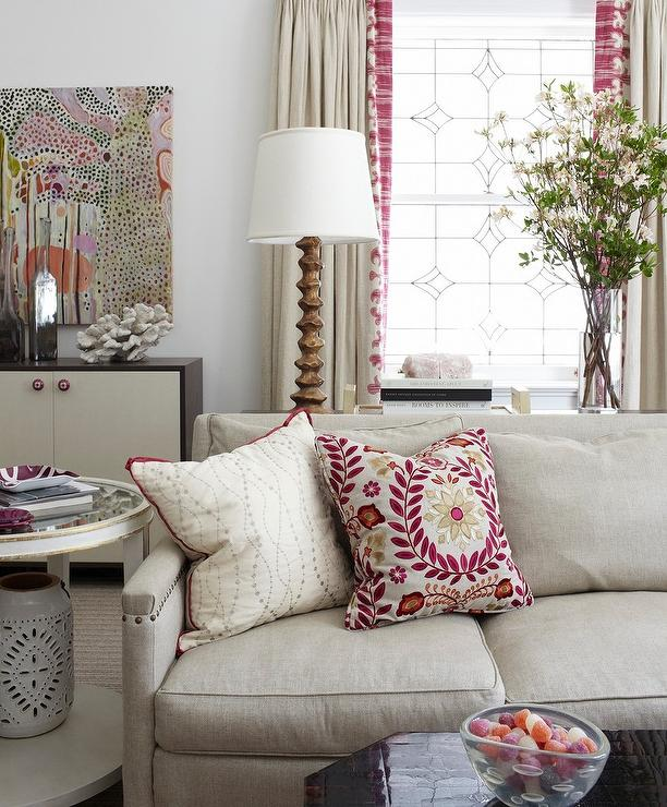 View Full Size. Beautifully Design Living Features A Beige Linen Sofa  Accented With ...