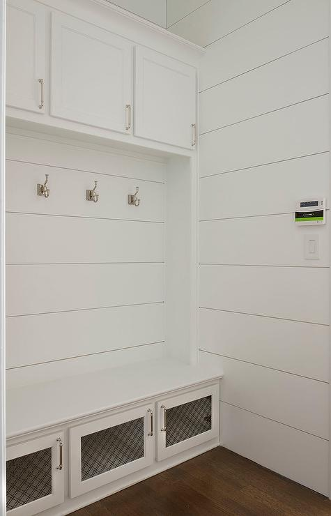 White Mudroom Bench With Metal Lattice Storage Cabinet Doors Cottage Laundry Room
